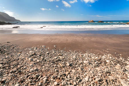 Beach with volcanic stones, Lanzarote, Canary Islands, Spain photo