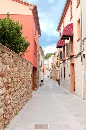 siesta: Narrow medieval street in Spain, Collbato, Spain
