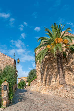 Street in Peratallada on a bright summer day, Spain photo