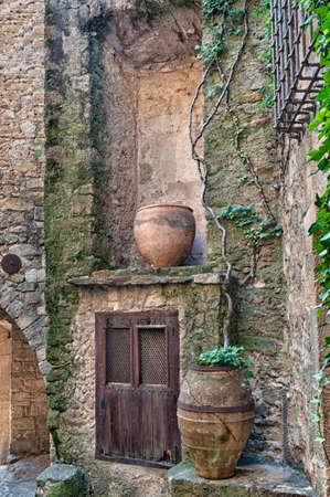 Old wooden door in the ancient city of Peratallada, Spain. photo
