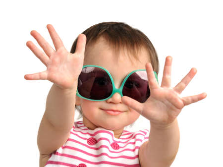 Cute little girl wearing sunglasses isolated photo