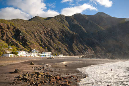 Rocky beach surrounded by a hill in Spain, Tenerife island photo