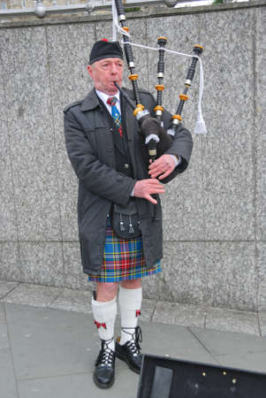 Bagpiper blowing his pipes, Edinburgh, Scotland
