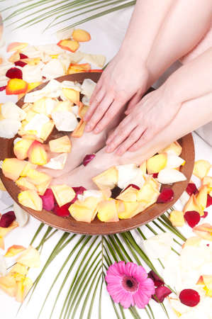 handcare: Pedicure and manicure spa with flowers and petals