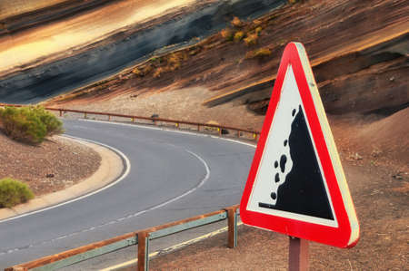 landslip: Road sign &quot,falling stones&quot, Tenerife, Canary islands, Spain Stock Photo