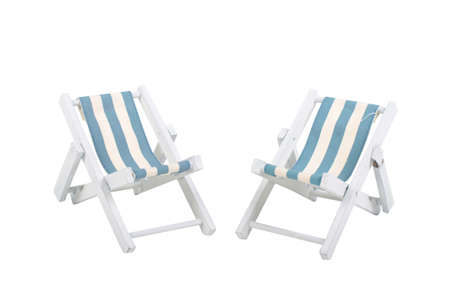 sunbed: Two white and blue beach chairs isolated on white