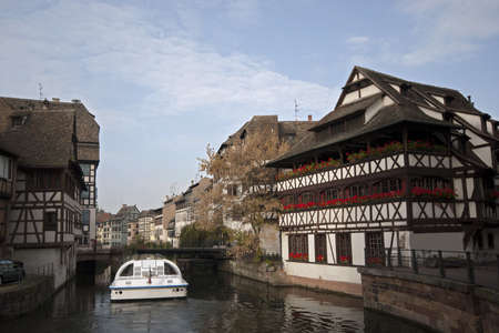 River with Traditional Half-Timbered Houses at the both banks, Strasbourg, France photo