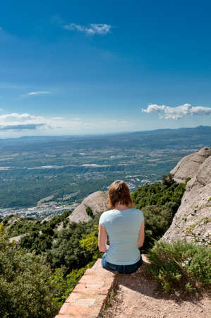 Young woman enjoying the magnifisent view of Montserrat Mountains photo