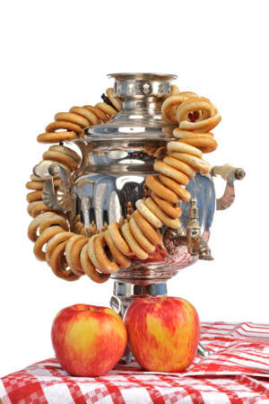 pewter mug: Tea ceremony with Russian samovar with bagels and apples