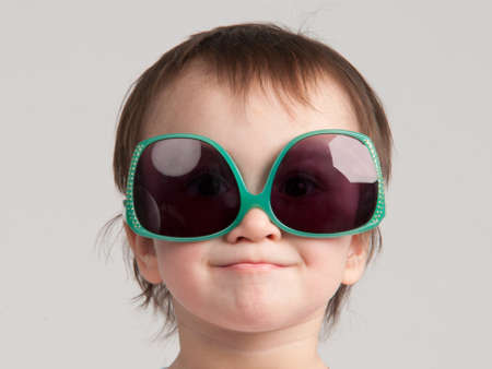 Portrait of little girl with sunglasses photo