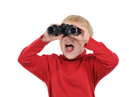 Happy boy with binoculars, isolated on white photo