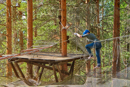 rope bridge: Young woman puzzled in adventure rope park
