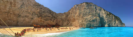 paradise beach: ZAKINTHOS ISLAND, GREECE - JUNE 2015: Tourists in famous Navagio Bay with Wrecked Ship Editorial