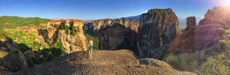 monastery nature: Young Girl Admiring Meteora Mountain and Monastery Panoramic View, Greece