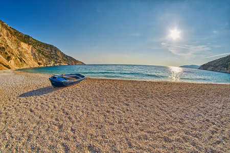 background settings: Old Abandoned Fishermen Boat at Empty Sunset Myrtos Beach in Kefalonia, Greece