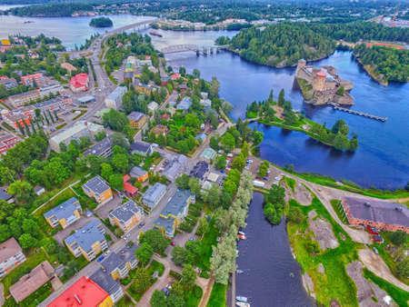 Aerial view of Olavinlinna Olofsborg Medieval 15th century Castle and Savonlinna town in Finland.