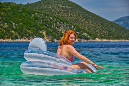 sea bed: Young Woman in inflatable Matress relaxing in the Sea