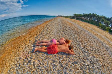 skala: Young Couple Relaxing on a Skala Beach in Kefalonia, Greece
