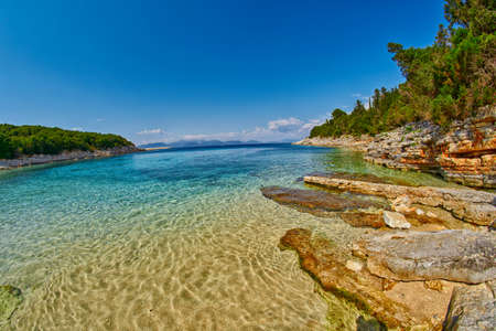 clear waters: Fiskardo Foki Beach of Kefalonia, Greece with Crystal Clear Waters