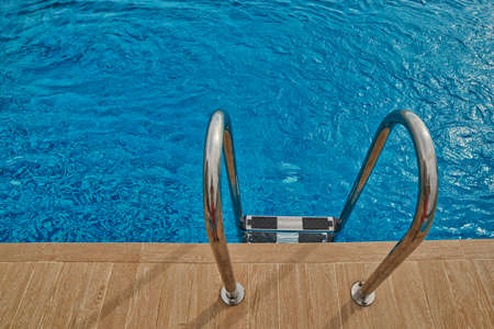 waterpool: Refreshing Swimming Pool Welcoming Stairs Abstract Background