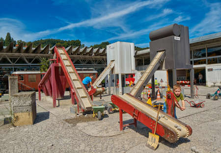LUZERN, SWITZERLAND - 10 August 2016: Child boy enjoying construction site playground in Swiss museum of transport