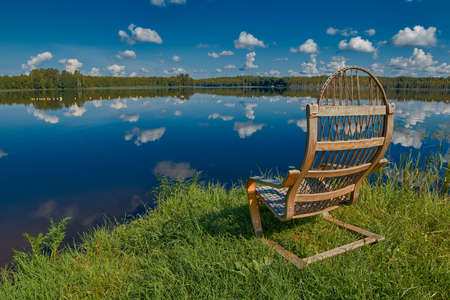 adirondack chair: Idyllic Relaxing Russian Lake Beach Landscape with Wooden Chair