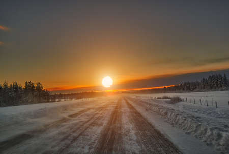 Sunset over scenic road, Lapland Finland Stock Photo