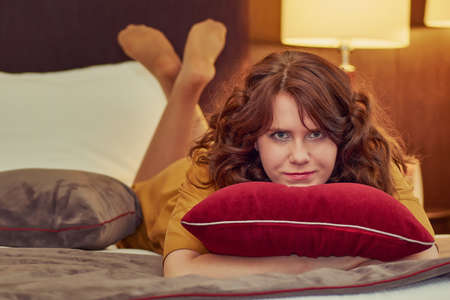 Artistic Portrait of  Pretty Business Style Dressed Woman Relaxing in a Hotel Room