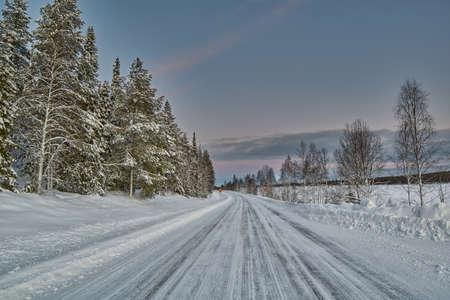 polar light: Winter Road in Finland in soft warm midday polar light
