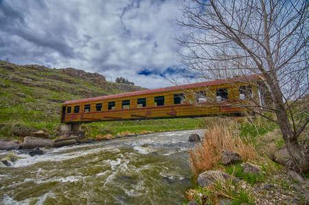 abandoned car: Surreal Rusty Bridge in Georgia made of Abandoned Train Car