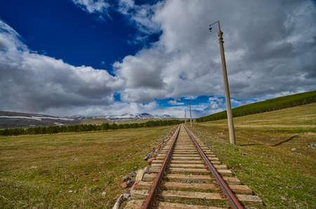 Vintage Railway track in Georgia leadin towards horizon Stock Photo