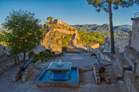 Beautiful Splashing fountain in Xativa Castle of Spain at Sunset