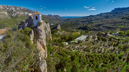 High-Resolution Panorama of Guadalest Castle in Alicante, Spain. Mediterranean sea is visible at the horizon. Editorial