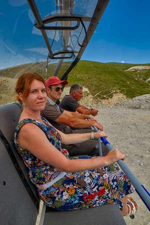 GODERDZI, GEORGIA - 08 AUGUST 2017: Newly-built modern Cable Car and Rural mountain landscapes of Georgian Adjara region near Goderdzi ski resort and village of Khulo