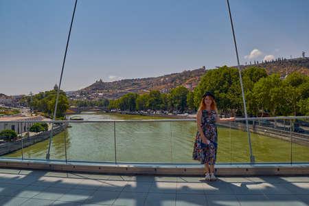Young Beautiful Woman on Peace Bridge in Tbilisi