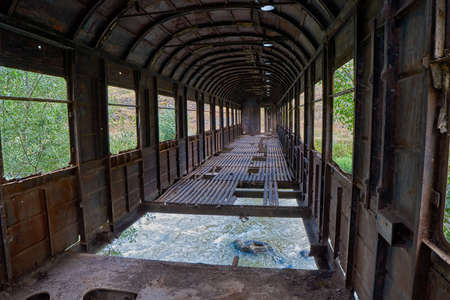 Inside Strange bridge made from old abandoned train car in Georgia