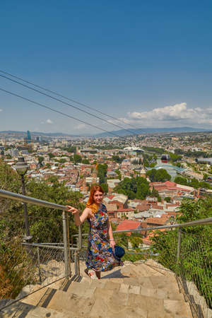 Young Woman Tourist Against Center of Tbilisi Cityscape