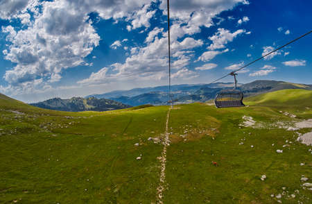 Long Funiculars ropeway line in Scenic Mountains Landscape