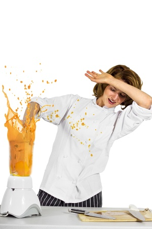messy kitchen: the chef forgot to put the lid on the blender Stock Photo