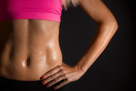 sweat girl: female abdominal muscles Stock Photo