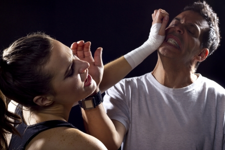 young fit woman fighting a man photo