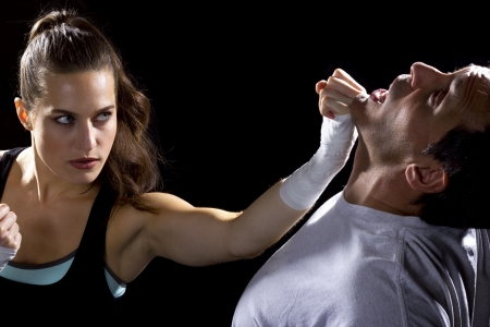 female MMA fighter fighting a man photo