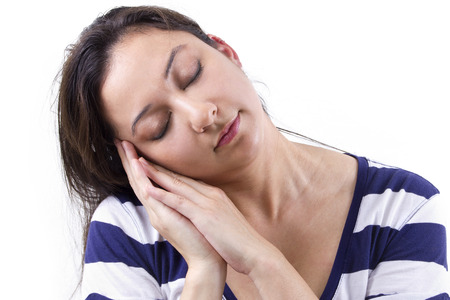 woman exagerating a sleeping gesture
