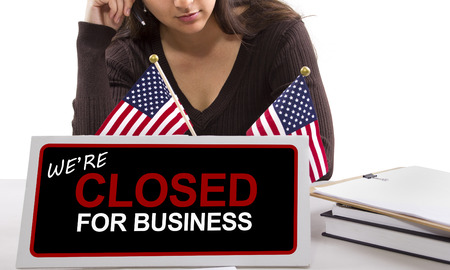 vrouw met een bureau bord met gesloten voor het bedrijfsleven Stockfoto