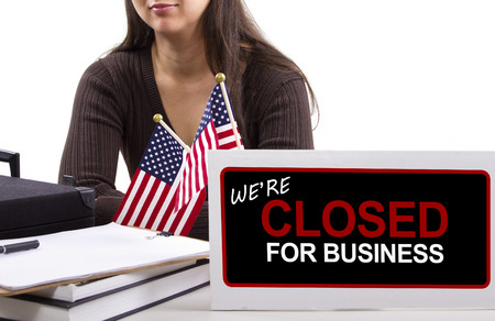 bureaucratic: woman with a desk sign showing closed for business Stock Photo