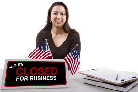 time deficit: woman with a desk sign showing closed for business Stock Photo