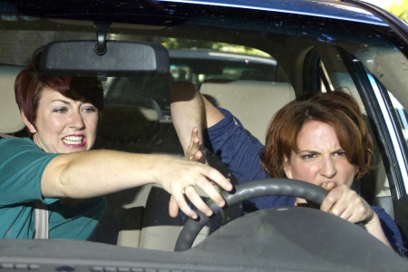 reckless: annoying female passenger by being a backseat driver