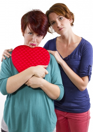 heart problems: consoling a friend suffering from a broken heart  Stock Photo