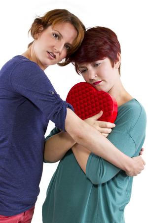 consoling a friend suffering from a broken heart  Reklamní fotografie