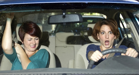 reckless driver and scared female passenger in a car photo